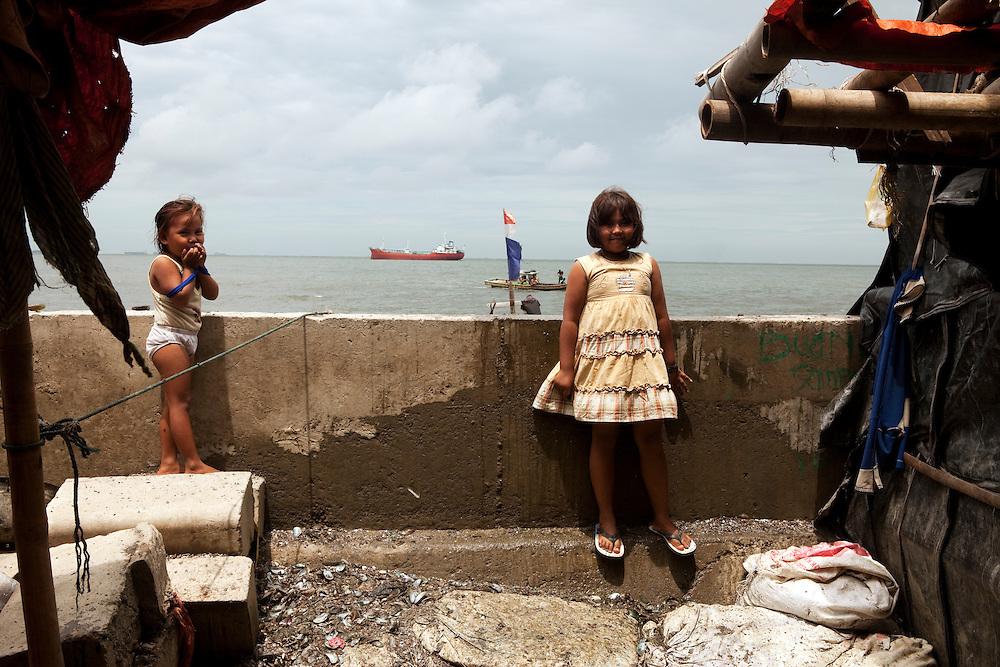 Children play in a Slum area in North Jakarta, Jakarta, Indonesia.