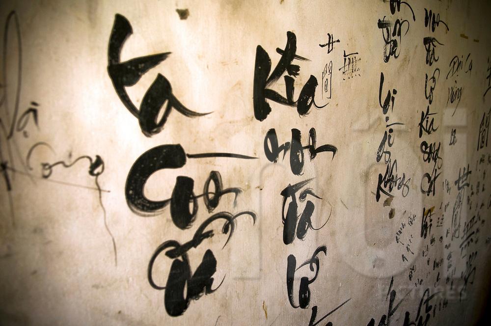 Wall painted with vietnamese words, Nha Trang, Khanh Hoa area, Vietnam, Asia.