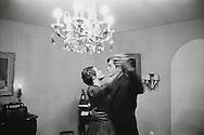 1959. Alain Delon et Romy Schneider having an intimate dance all alone under a chandelier.<br /> <br /> 1959. Alain Delon et Romy Schneider pendant une danse intime seul sous un lustre .