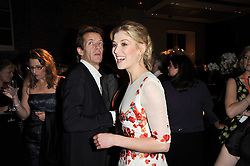 ROSAMUND PIKE and ROBIE UNIACKE at the BAFTA Nominees party 2011 held at Asprey, 167 New Bond Street, London on 12th February 2011.