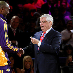 Los Angeles Lakers' Kobe Bryant recieves his ring from NBA Commissioner David Stern before a basketball game at the Staples Center on Tuesday, October 27, 2009 in Los Angeles. (SGVN/Staff Photo by Keith Birmingham/SPORTS)