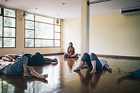 Travelers and guests meditate before a Dance Mandala class at The Yoga Tree in Chiang Mai, Thailand.