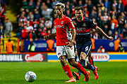 Charlton Athletic forward Lyle Taylor (9) and Doncaster Rovers defender Andrew Butler (6) during the EFL Sky Bet League 1 second leg Play-Off match between Charlton Athletic and Doncaster Rovers at The Valley, London, England on 17 May 2019.