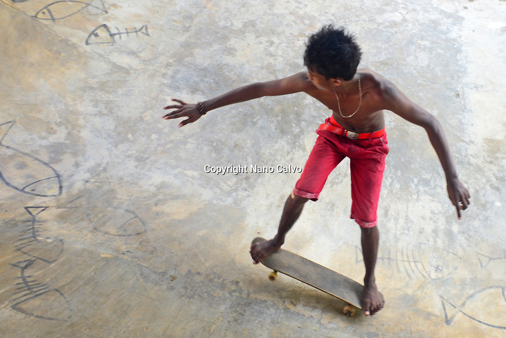 Young boys skateboarding in Midigama, Sri Lanka