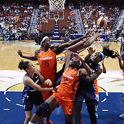 UNCASVILLE, CONNECTICUT- JUNE 3:  Aneika Henry-Morello #15 and Chiney Ogwumike #13 of the Connecticut Sun challenge for a rebound with Matee Ajavon #10 and Rachel Hollivay #14 of the Atlanta Dream during the Atlanta Dream Vs Connecticut Sun, WNBA regular season game at Mohegan Sun Arena on June 3, 2016 in Uncasville, Connecticut. (Photo by Tim Clayton/Corbis via Getty Images)