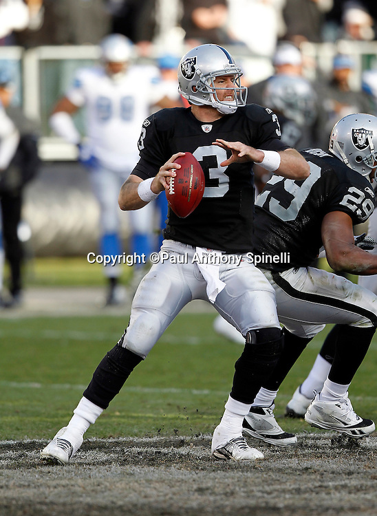 Oakland Raiders quarterback Carson Palmer (3) drops back to pass during the NFL week 15 football game against the Detroit Lions on Sunday, December 18, 2011 in Oakland, California. The Lions won the game 28-27. ©Paul Anthony Spinelli