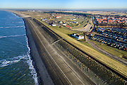 Nederland, Noord-Holland, Gemeente Schoorl, 11-12-2013; Petten, Hondsbossche en Pettemer Zeewering gezien vanuit zee, richting Petten.<br /> De dijk is aangelegd als zeewering nadat de oorsrponkelijke duinen weggeslagen waren. Door erosie kalven de duinen langs de kust steeds verder af, de dijk steekt daardoor steeds meer uit in zee.<br /> Hondsbossche and Pettemer seawall seen from the sea in the direction of the village Petten<br /> The dike was built as a seawall after the primal dunes were washed away. Because of erosion the dunes decrease in size, therefore the sewall sticks more and more out into the sea.<br /> luchtfoto (toeslag op standard tarieven);<br /> aerial photo (additional fee required);<br /> copyright foto/photo Siebe Swart