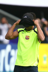 PARIS, FRANCE - TUESDAY, MAY 16th, 2006: Who is the masked man out to stop Arsenal? FC Barcelona's Ronaldinho adjusts his has trouble putting on his bandana during training ahead of the UEFA Champions League Final against Arsenal at the Stade de France. (Pic by David Rawcliffe/Propaganda)