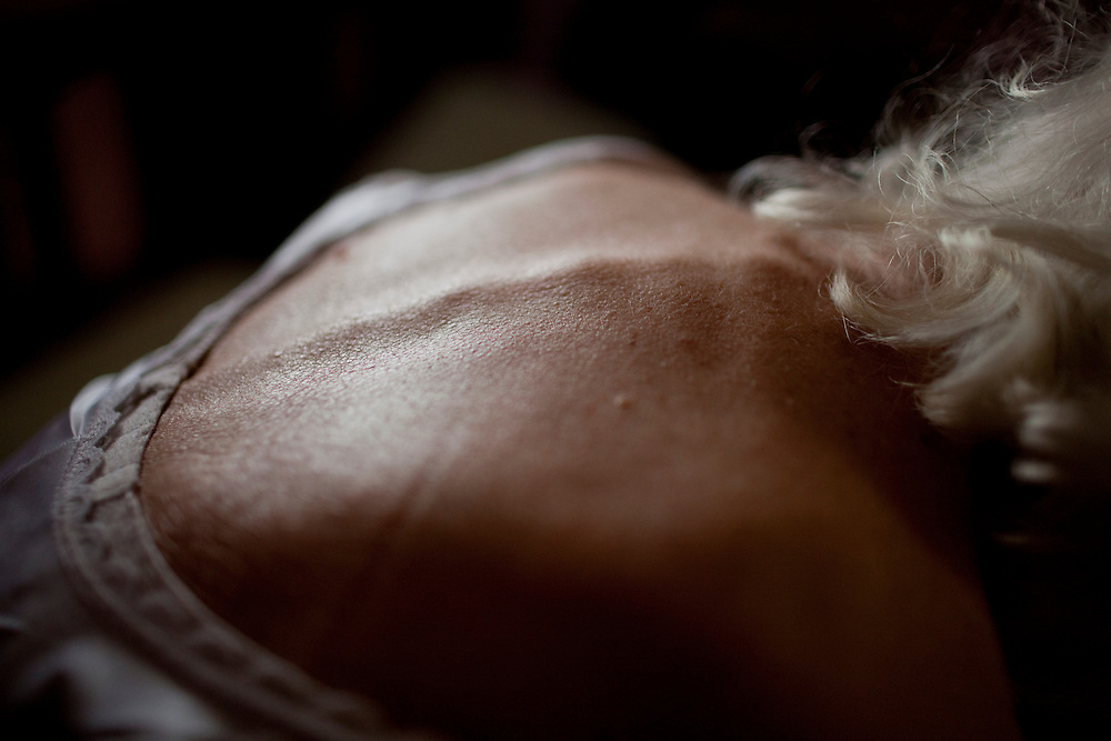 "Morning light illuminates the skin on Mary Triplet's back. She is utterly dependent on Bernard helping her. When asked about it, Bernard says, "" She's put up with me and all the things that I've done wrong. I just know I have to look out for her."""