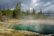 On an overcast day, the sun came out for a minute over the Abyss Pool in Yellowstone National Park. Located in the West Thumb Geyser Basin, the turquoise pool is 53 feet deep.