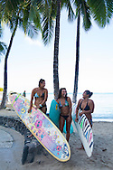 Hawaiian women surfers who participated in the Duke's Oceanfest Wahine Longboard Pro on the beach with their surf boards just after their first heat in the competition.  Waikiki beach, Honolulu, Hawaii, Oahu