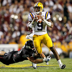 Sep 18, 2010; Baton Rouge, LA, USA;  LSU Tigers quarterback Jordan Jefferson (9) runs away from Mississippi State Bulldogs defensive tackle Johnathan McKenzie (57) during the second half at Tiger Stadium. The LSU Tigers defeated the Mississippi State Bulldogs 29-7. Mandatory Credit: Derick E. Hingle