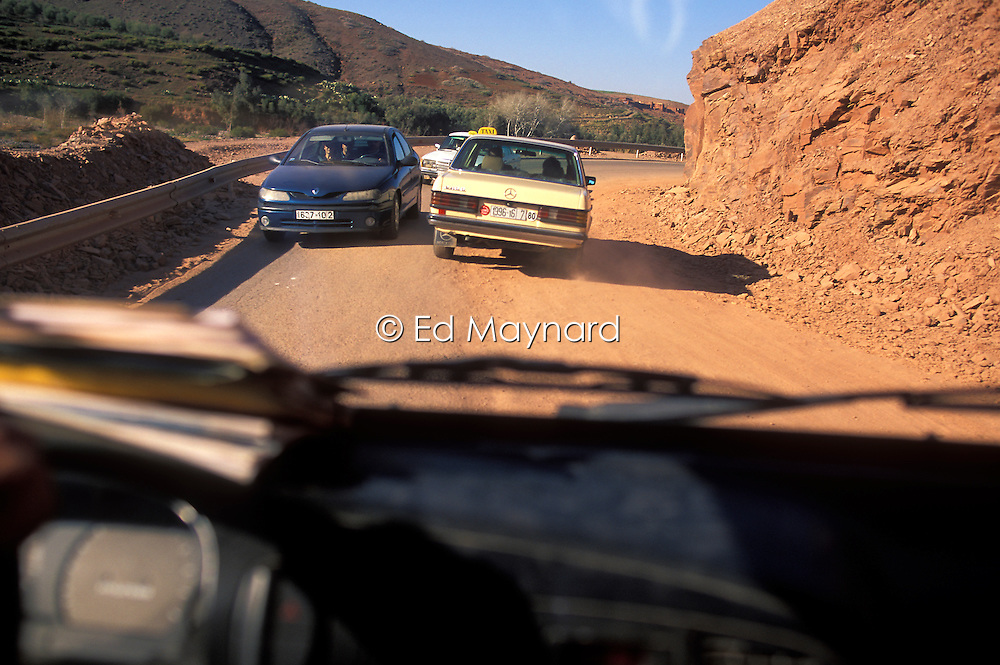 Travelling on a road covered with sand and rocks after a recent landslide between Imlil and Marrakech in the High Atlas, Morocco.