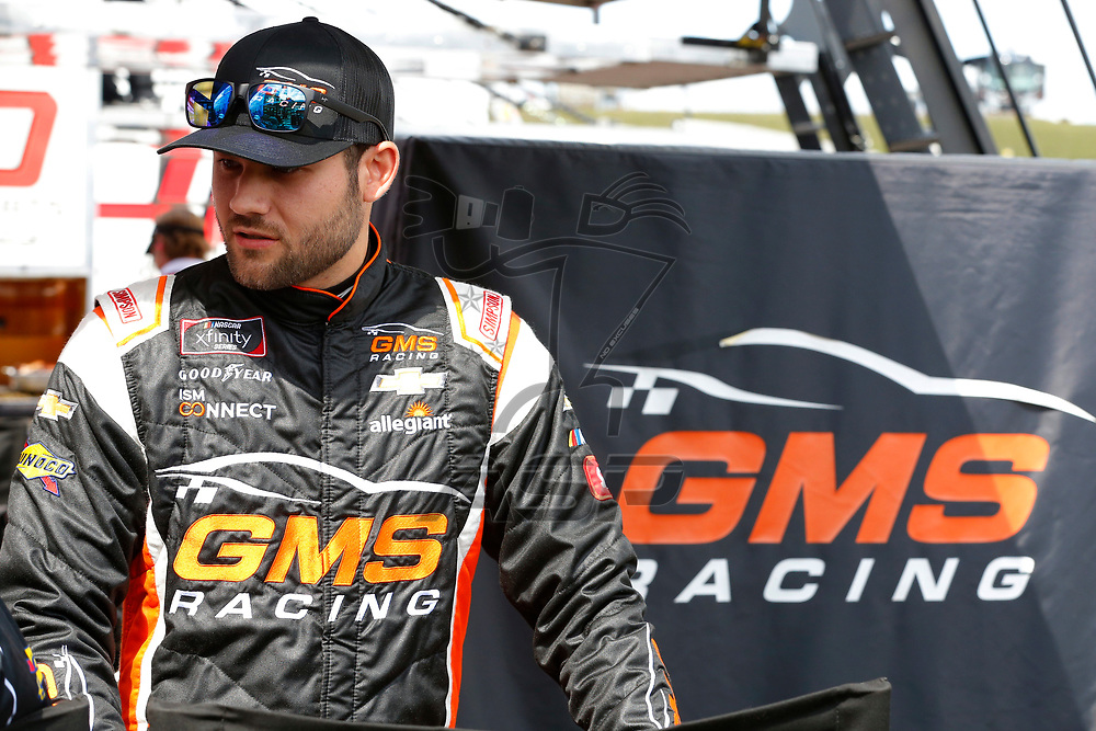 Casey Roderick (23) hangs out in the garage during practice for the US Cellular 250 at Iowa Speedway in Newton, Iowa.
