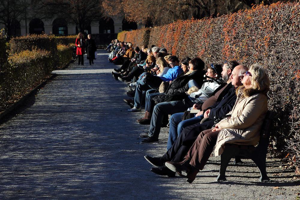 Munich residents enjoy a sunny early winter's day in Hofgarten