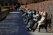 Munich residents enjoy a sunny early winter's day in Hofgarten