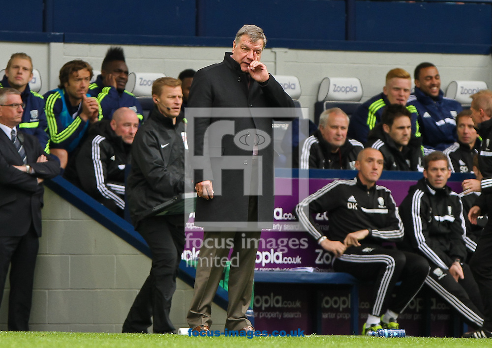 West Ham United manager Sam Allardyce (centre) during the Barclays Premier League match at The Hawthorns, West Bromwich<br /> Picture by Tom Smith/Focus Images Ltd 07545141164<br /> 26/04/2014