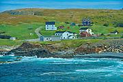 Rocky shoreline, houses and the Atlantic Ocean on the Bonavista Peninsula.<br />Elliston<br />Newfoundland & Labrador<br />Canada