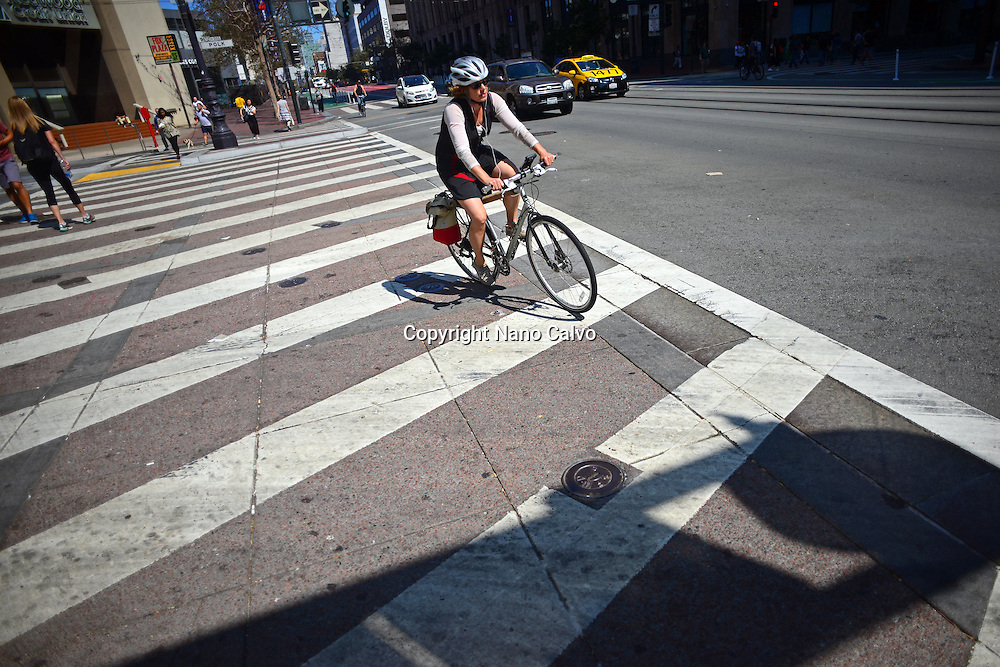 Woman rides a bicycle in San Francisco.