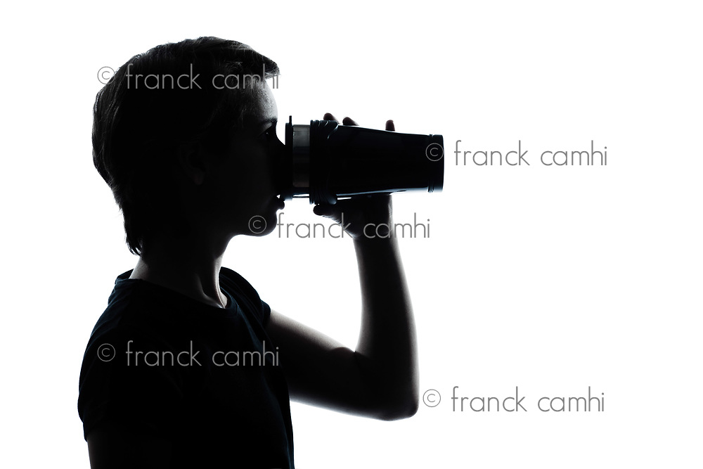 one caucasian young teenager drinking at thermos travel mug  silhouette boy or girl portrait in studio cut out isolated on white background