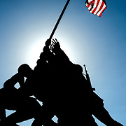 Silhouette of the massive state of the Iwo Jima Memorial (formally the Marine Corps War Memorial) in Arlington, Virginia, next to Arlington National Cemetery. The monument was designed by Felix de Wledon and is based on an iconic Associated Press photo called the Raising the Flag on Iwo Jima by Joe Rosenthal. It was dedicated in 1954.