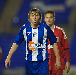 BIRKENHEAD, ENGLAND - Thursday, March 25, 2010: Wigan Athletic's Tomasz Kupisz during the FA Premiership Reserves League (Northern Division) match in action against Liverpool at Prenton Park. (Photo by David Rawcliffe/Propaganda)