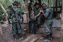 El Diamante, Meta, Colombia - 16.09.2016        <br /> <br /> Guerilla camp during the 10th conference of the marxist FARC-EP in El Diamante, a Guerilla controlled area in the Colombian district Meta. Few days ahead of the peace contract passing after 52 years of war with the Colombian Governement wants the FARC decide on the 7-days long conferce their transformation into a unarmed political organization. <br /> <br /> Guerilla-Camps zur zehnten Konferenz der marxistischen FARC-EP in El Diamante, einem von der Guerilla kontrollierten Gebiet im kolumbianischen Region Meta. Wenige Tage vor der geplanten Verabschiedung eines Friedensvertrags nach 52 Jahren Krieg mit der kolumbianischen Regierung will die FARC auf ihrer sieben taegigen Konferenz die Umwandlung in eine unbewaffneten politischen Organisation beschlieflen. <br />  <br /> Photo: Bjoern Kietzmann