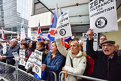 © Licensed to London News Pictures. 08/04/2018. LONDON, UK. Demonstrators with signs at a protest calling for Jeremy Corbyn, leader of the Labour party, to be held to account.  The event was organised by the Campaign Against Anti-Semitism, outside the Labour Party's headquarters in central London.  Photo credit: Stephen Chung/LNP