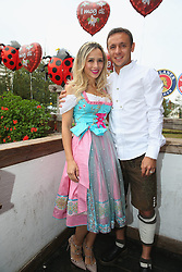 05.10.2014, Theresienwiese, München, GER, 1. FBL, FC Bayern Muenchen am Oktoberfest, im Bild Rafinha attends with his girlfriend Carolina the Oktoberfest beer festival at Kaefer Wiesnschaenke tent at Theresienwiese on 2014/10/05. EXPA Pictures © 2014, PhotoCredit: EXPA/ Eibner-Pressefoto/ Pool<br /> <br /> *****ATTENTION - OUT of GER*****