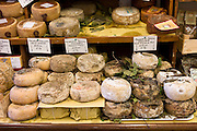 Italian artisan cheese shop, Del Bottega Naturista in Corso Rossellino including Pecorino Stagionato aged cheese in Pienza, Tuscany, Italy RESERVED USE - NOT FOR DOWNLOAD - FOR USE CONTACT TIM GRAHAM