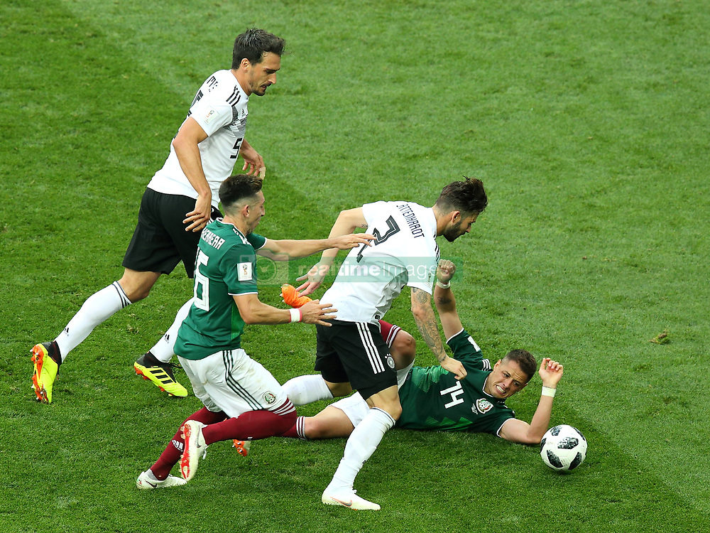 June 17, 2018 - Moscow, Russia - June 17, 2018, Russia, Moscow, FIFA World Cup, First round, Group F, Germany vs Mexico at the Luzhniki stadium. Player of the national team Mats Hummels, Javier Hernndez Balcasar (Credit Image: © Russian Look via ZUMA Wire)