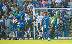 PORTSMOUTH, ENGLAND - Saturday, March 21, 2009: Portsmouth's Peter Crouch rises above the Everton defence to score the winning goal, his second of the match, during the Premiership match at Fratton Park. (Photo by David Rawcliffe/Propaganda)