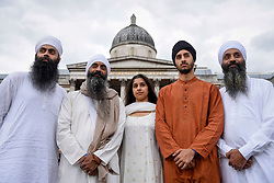 © Licensed to London News Pictures. 29/04/2017. London, UK. Members of Gurmat Sangeet Academy form part of the entertainment at the Sikh festival of Vaisakhi taking place in Trafalgar Square and hosted by the Mayor of London.  The festival celebrates the beginning of Sikhism, a collective faith which is practiced by more than 20 million people worldwide.   Photo credit : Stephen Chung/LNP