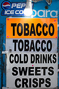 A detail of a street vendor's kiosk notices for tobacco, drinks and other confectionary, on 5th March 2019, in London, England.