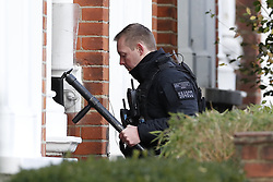 © Licensed to London News Pictures. 18/01/2019. London, UK. Police officers carry equipment enter the property in Balham, south London where police are negotiating with a man who is inside the house with a knife. Photo credit: Peter Macdiarmid/LNP