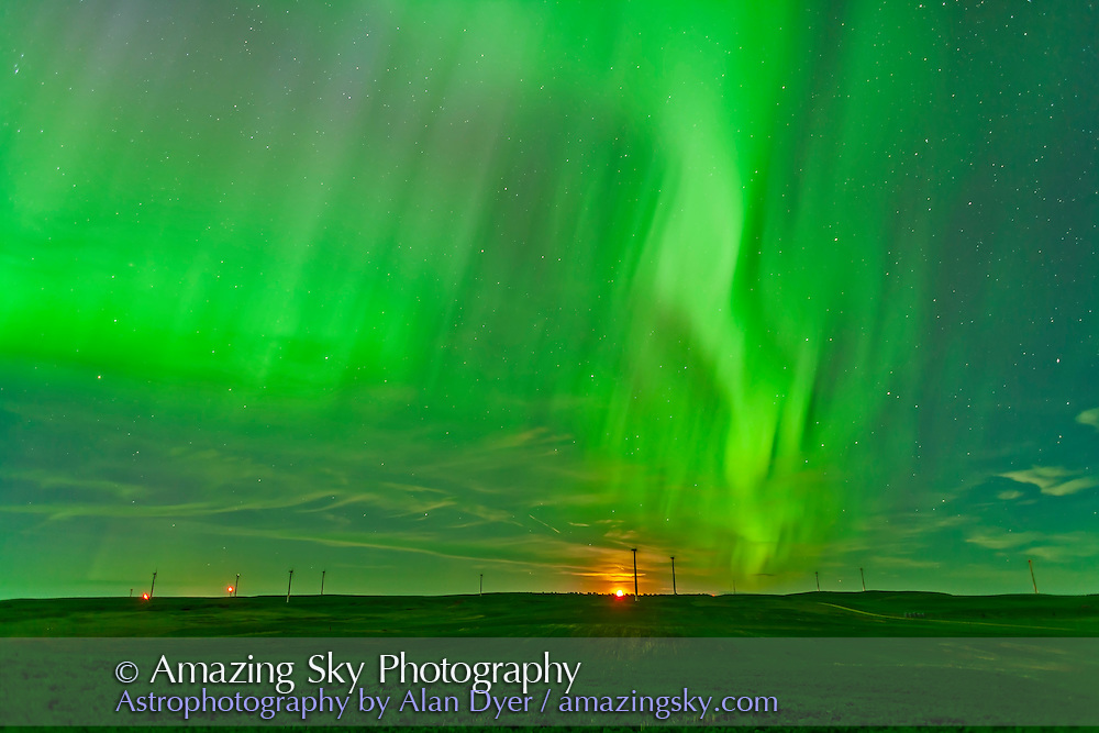 The northern lights on June 28/29, 2013 as seen from the Wintering Hills WInd Farm near Drumheller, Alberta, on a night the aurora covered the sky. This is a single frame from a 300-frame time-lapse movie. It is a 14-second exposure at f/2 with the 24mm lens and Canon 5D MkII at ISO 400. The Moon is just rising as the display is reaching a peak in intensity.