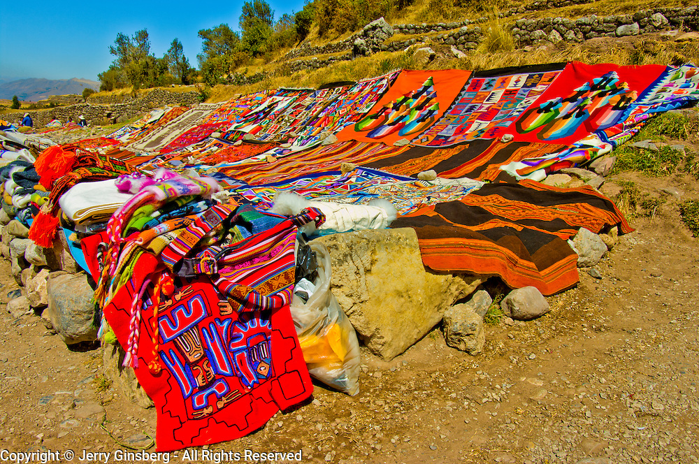 South America, Peru, Cuzco, Cusco, Tombomachay, Hand woven rugs for sale at historic Tambomachay in the hills above Cuzco, Peru.