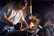 Frank Turley makes custom iron pieces in his blacksmith shop in Santa Fe, New Mexico.