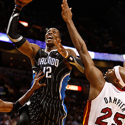 March 3, 2011; Miami, FL, USA; Orlando Magic center Dwight Howard (12) shoots over Miami Heat center Erick Dampier (25) during the second quarter at the American Airlines Arena.    Mandatory Credit: Derick E. Hingle