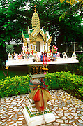 THAILAND, SOUTH, PHUKET ISLAND Buddhist spirit house, for spirits of site disturbed by construction, in front of homes and businesses