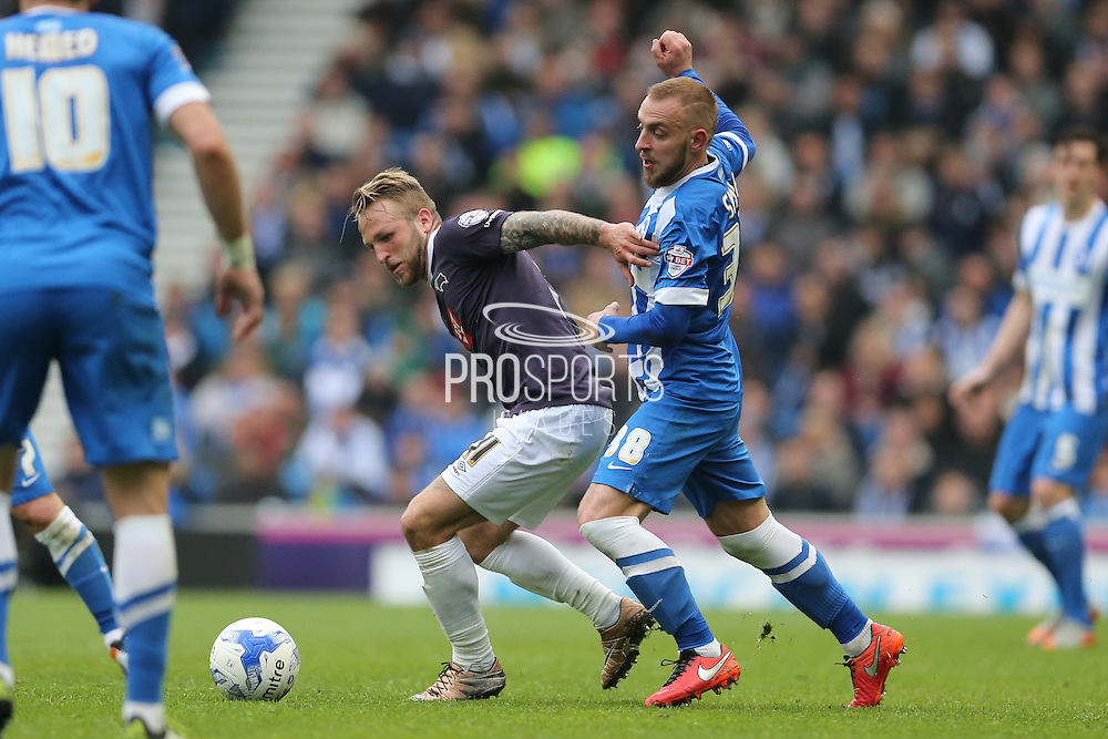 Derby County striker Johnny Russell (11) and Brighton striker Jiri Skalak (38) during the Sky Bet Championship match between Brighton and Hove Albion and Derby County at the American Express Community Stadium, Brighton and Hove, England on 2 May 2016.