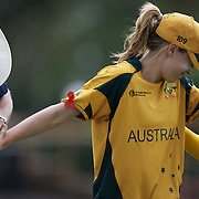 Australian bowler Ellyse Perry is led off the field by Captain Karen Rolton after dislocating her finger attempting a catch. Her finger was relocated by Australian Physiotherapist Kevin Sims much to Ellyse Perry's anguish during the Australia V New Zealand group A match at North Sydney Oval in the ICC Women's World Cup Cricket Tournament, in Sydney, Australia on March 8, 2009. New Zealand beat Australia by 13 runs in the (D/L method)  rain affected match. Photo Tim Clayton