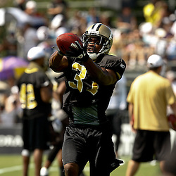 August 1, 2010; Metairie, LA, USA; New Orleans Saints safety Pierson Prioleau (31) catches a pass during a training camp practice at the New Orleans Saints practice facility. Mandatory Credit: Derick E. Hingle