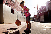 BETHLEHEM, PA – JUNE 2, 2011: Jaedyn Lawon, 6, plays at the junction of Mechanic and State Street in Bethlehem, Pennsylvania on June 2, 2011.<br /> <br /> As the population of second and third generation Hispanics increases dramatically in the United States, a new boldness can be sensed among Latinos in America, stretching far beyond the southern border states. Demographers in Pennsylvania say the towns of Bethlehem, Allentown and Reading are set to become majority-minority cities, where Hispanics comprise a bigger portion of the population than whites. As this minority population increases dramatically in the region, Latinos are inching closer to their own realization of the American Dream, while gradually shifting the physical and cultural landscapes of their communities.