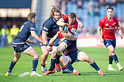 Peter O'Mahony (#6) of Munster Rugby attempts to break tackles during the Heineken Champions Cup quarter-final match between Edinburgh Rugby and Munster Rugby at BT Murrayfield Stadium, Edinburgh, Scotland on 30 March 2019.