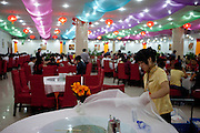 Restaurant for a few hundred guests at the same time at a Jadeite museum and factory with shops close to Beijing. Beijing is the capital of the People's Republic of China and one of the most populous cities in the world with a population of 19,612,368 as of 2010.