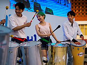 "15 JUNE 2018 - SEOUL, SOUTH KOREA: A drum line performs during a rally to mark the anniversary of the signing of the June 15th North–South Joint Declaration between South Korea and North Korea. The Declaration was negotiated by late South Korean President Kim Dae-jung and North Korean leader Kim Jong-il and signed on 15 June 2000. It was a part of South Korea's ""Sunshine Policy,"" which guides the South's relationship with North Korea. This year's observance of the anniversary was bolstered by the recent thawing in relations between North Korea and South Korea and the US.   PHOTO BY JACK KURTZ"