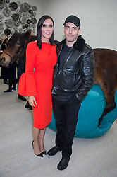 LINZI STOPPARD and WILL STOPPARD at the opening of the exhibition Champagne Life in celebration of 30 years of The Saatchi Gallery, held on 12th January 2016 at The Saatchi Gallery, Duke Of York's HQ, King's Rd, London.