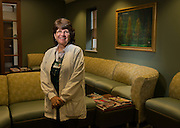 Kathleen Trace, Director of Area Health Education Center & Community Health Programming stands in the newly rennovated lobby of the free clinic in Grovesner Hall in the Heritage College of Osteopathic Medicine.