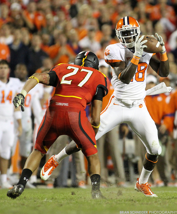 October 15, 2011; College Park, MD, USA; Clemson Tigers wide receiver Jaron Brown (18) catches a pass against the Maryland Terrapins defensive back Titus Till (27) during the second half at Byrd Stadium. Brian Schneider-www.ebrianschneider.com